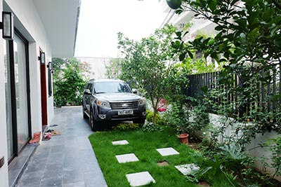 Charming 03BRs house to rent in Xom Chua, garden surroundings