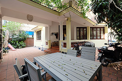 Large courtyard & Partly furnished house in Tay Ho to rent