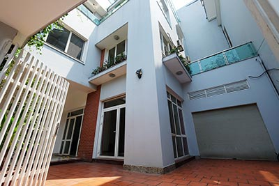 Modern unfurnished house with big courtyard on Dang Thai Mai
