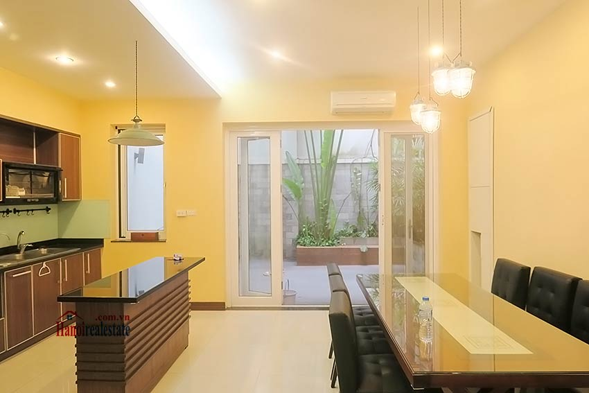 Semi furnished 03 bedroom house to let in Hai Ba Trung with nice courtyard 12